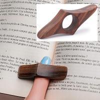 Mantener un libro abierto con el pulgar