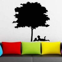 Vinilo árbol niño leyendo